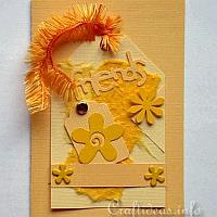 Cheery Yellow Tag Greeting Card with Flowers