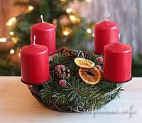 Christmas Centerpiece with Red Candles and Decorations