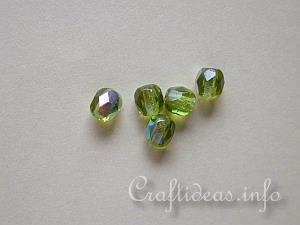 Faceted Round Shaped Glass Beads