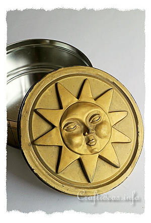 Recycling Craft for Summer - Gold Cookie Tin with Plaster of Paris Sunshine Motif