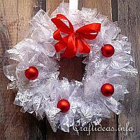 White Wreath with Red Decoration